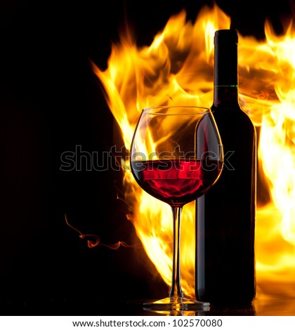 Red wine. Concept with fire.