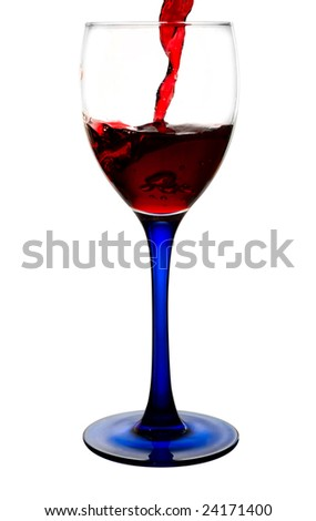 Red wine flowing to a glass. All is isolated with a clipping path - stock photo