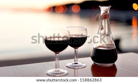 red wine for two in sunset