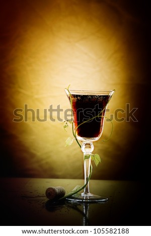 red wine glass against classic background