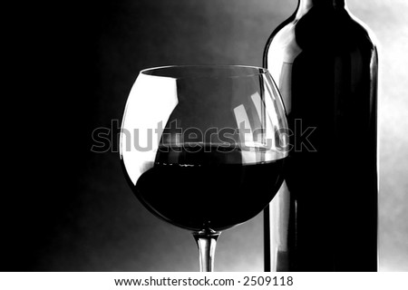 red wine , glass and bottle black and white