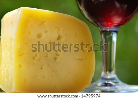 Red wine glass and cheese.