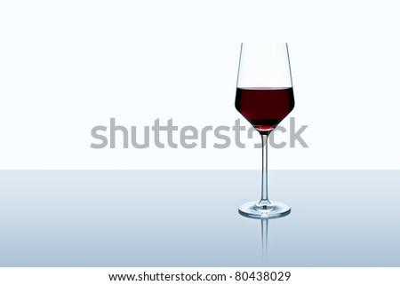 Red wine glass isolated on white background standing on a table