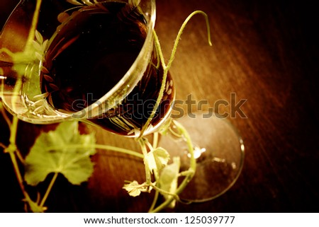 red wine glass isolated on wood background