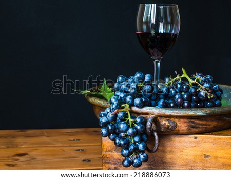 Red wine glass.Wine and grape, rustic wood background,winery.