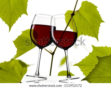 red wine glasses with grape leaves