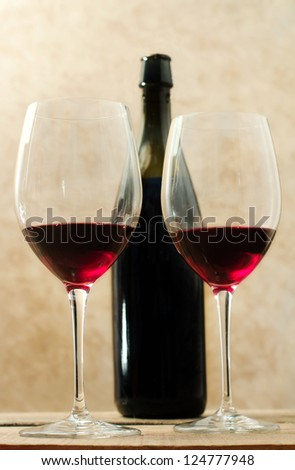 red wine glasses with wine bottle