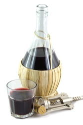 Red wine in a fiasco typical of the Italian tradition  isolated in whitw background