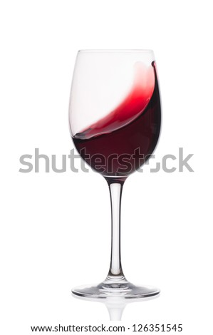 Red wine in a glass  on a white background