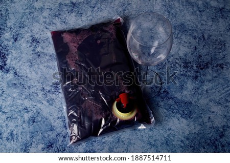 red wine in a 1.5 litre plastic bag on blue stone background  Сток-фото ©