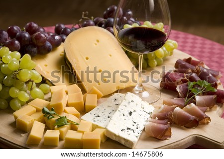 Red wine in fine glass and appetizers  on a table