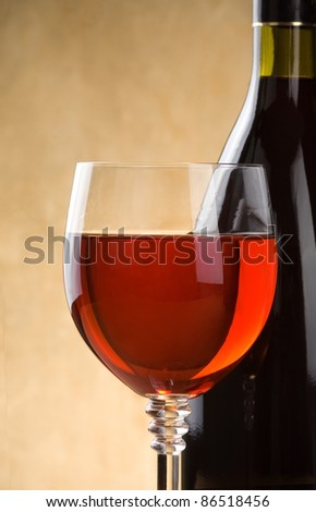 red wine in glass and bottle on wood background