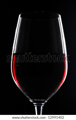red wine in glass on black