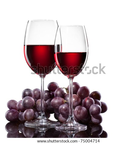Red wine in glasses with grape isolated on white - stock photo