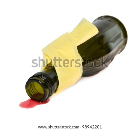 red wine is spilled from a green bottle with a yellow napkin on a neck