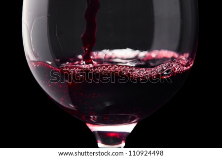 Red wine on a black background ,saved clipping path.