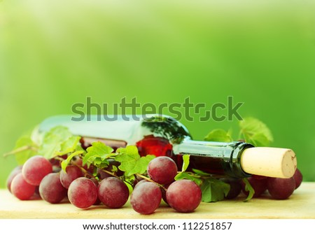 Red wine on green background