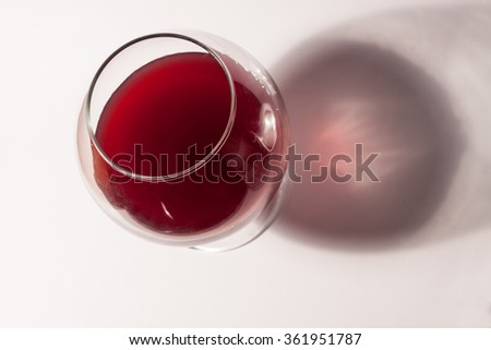 Red wine on white table. #361951787