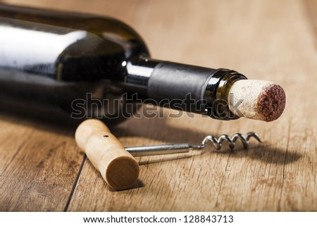 red wine on wooden background still life image