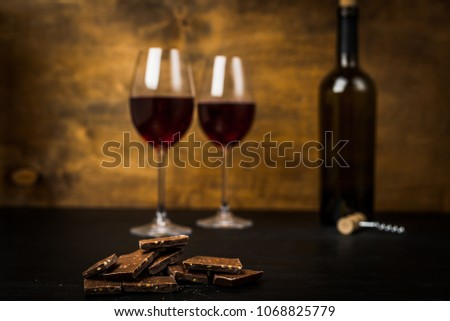 Red wine on wooden Board with stoppers and a corkscrew. On a wooden table. #1068825779