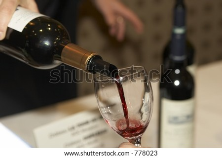 Red wine poured during a bordeaux wine tasting