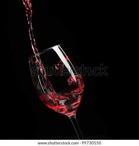 red wine poured into glass - stock photo