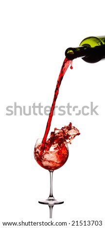 Red wine pouring down from a wine bottle against white background