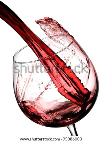 Red wine pouring in a glass, slow motion