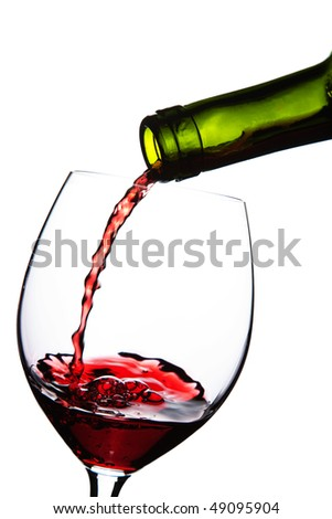 red wine pouring into glass isolated