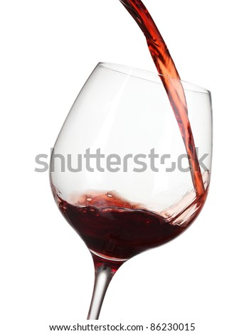 Red wine pouring into glass isolated on white