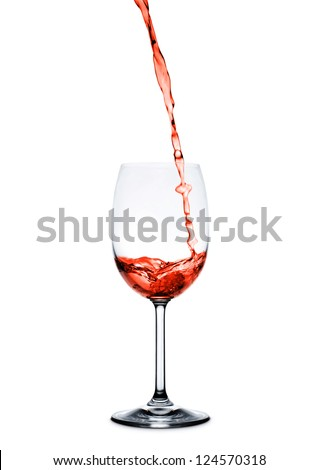 red wine pouring into wine glass isolated on white background