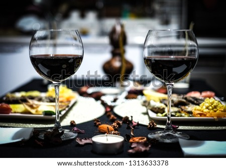 Red wine. Red wine in a glass. Dinner. Romantic dinner. Romantic dinner with red wine.