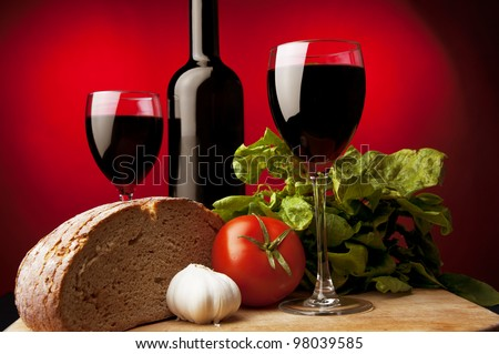 red wine,rye bread,garlic,green spinach, colored background