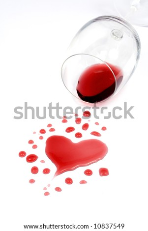 Red wine spilled from glass forming a heart shape
