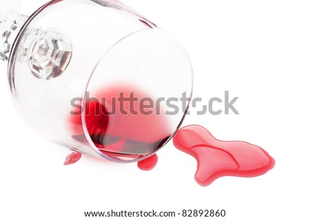Red wine spilled from glass over white background - stock photo