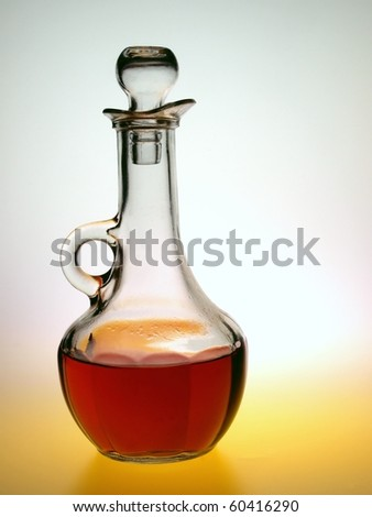 Red wine vinegar in cruet ready for salad. - stock photo