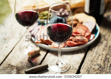 Red wine with charcuterie assortment on the background ストックフォト ©