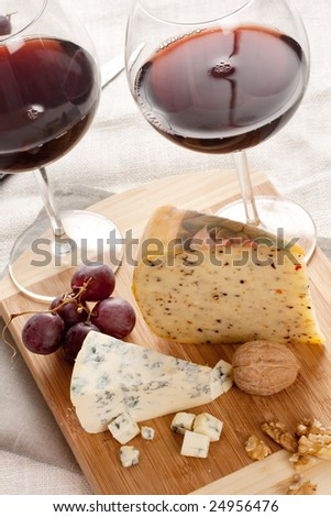 red wine with cheese on chopping board