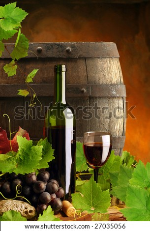 Red wine with fresh grapevine and cask - stock photo
