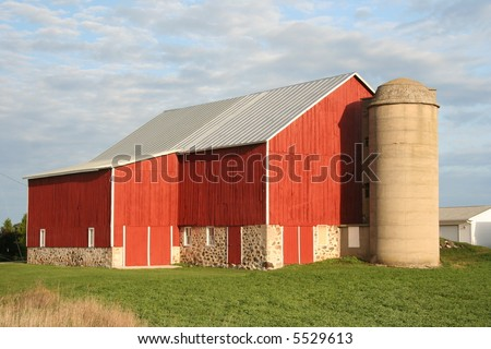 red Wisconsin dairy barn with cement silo