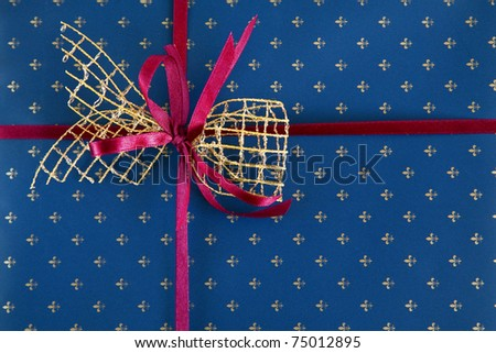 red with blue bow on a blue gift paper
