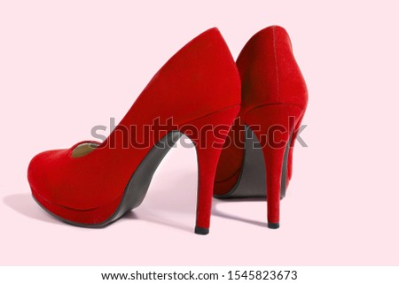 Red Woman Fashion High Heels Shoes Isolated On Pink Background. Closeup women bright summer footwear. Shopping and Fashion concept. Glamour and luxury ladies accessory. Selective focus #1545823673