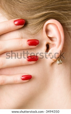Red woman fingers and ear.