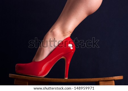 Red woman's shoe on high heel