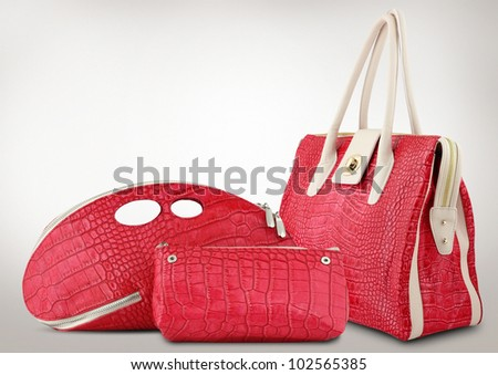 Red women bags on grey background