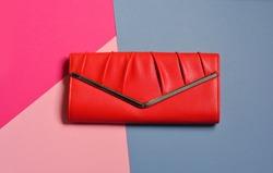 Red women's clutch, bag, purse, Glamorous fashion photo.