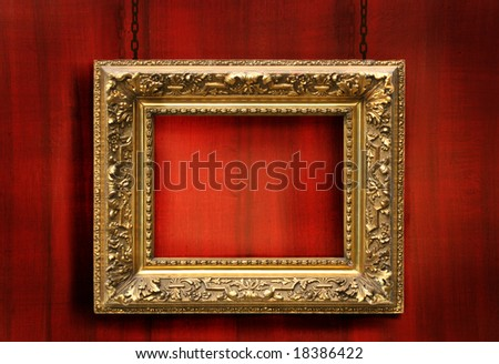 Red wood background with antique gold frame - stock photo