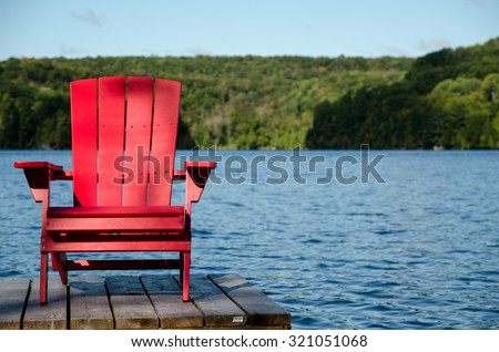 Red Wood Chair on Docks at Cottage Lake