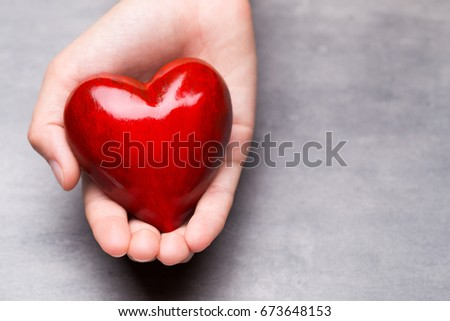 Red wood heart in child hands. #673648153