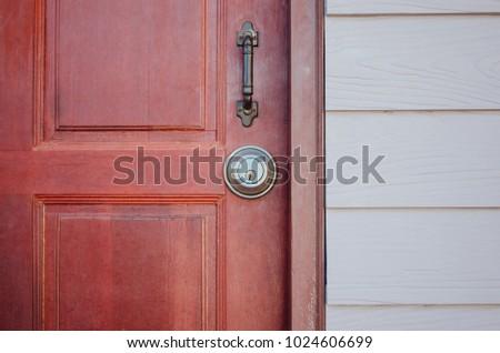 Red wooden  door and round metal door lock with handle grip #1024606699